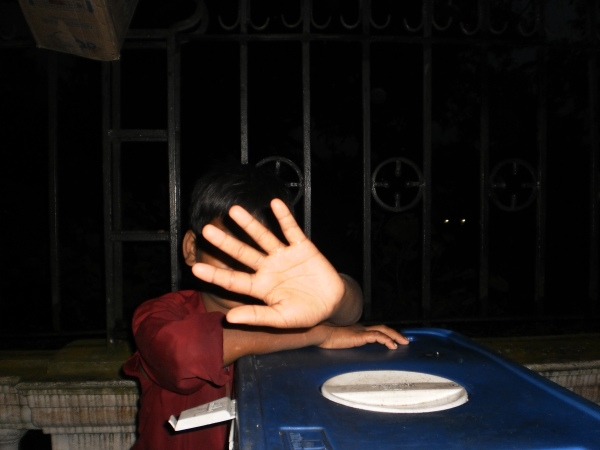 A shy kid, working at a tea stall