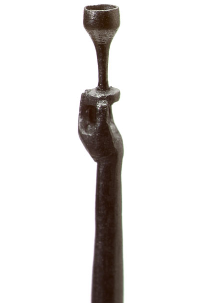 This carving shows a goblet being held by a hand, all carved from one pencil's graphite