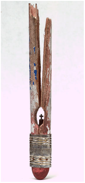 Using the eraser end of a pencil, Dalton created a tiny cross sculpture from the internal graphite
