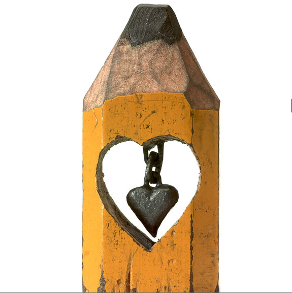 """""""I don't make any money from it but that's not what it's about for me. However, I would love for a gallery owner in England to fly me over to put on a show,"""" he said  Dalton hollowed out the centre of the wood, then carved the central column of graphite to create this hanging, linked heart"""